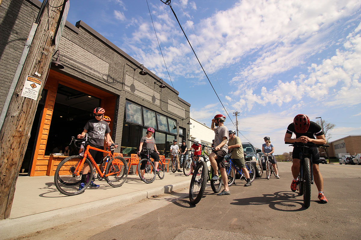 The National Bike Month and grand opening events included community bike rides, records and spin art.