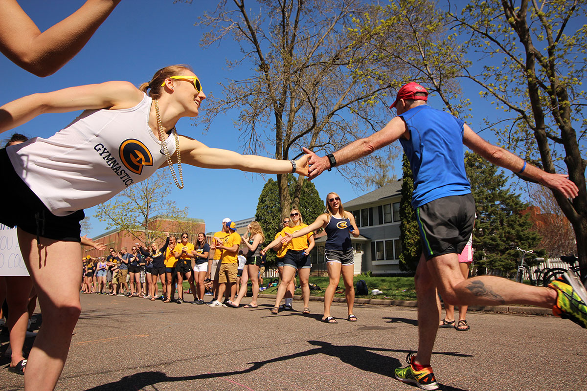 Students cheer on runners in the 2018 Eau Claire Marathon running through the Blugold Mile.