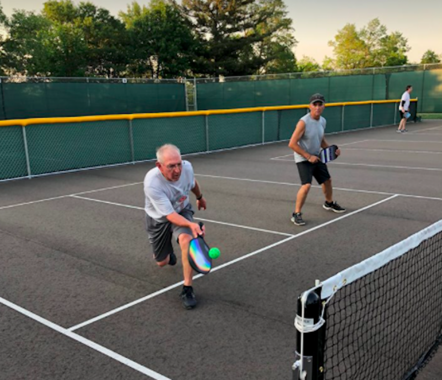 """Pickleball was born on an island near Seatle in 1965, according to the USAPA's website. The game originated as a backyard activity created by three fathers. There are several accounts as to why the game is called """"pickleball."""" One claims that a family's cocker spaniel, named """"Pickles,"""" used to chase after the wiffle ball."""