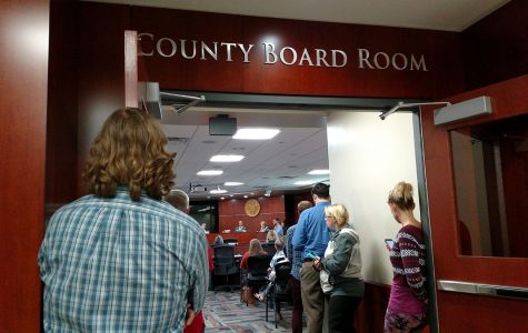 The room overflowed with people wanting to attend the city council meeting.