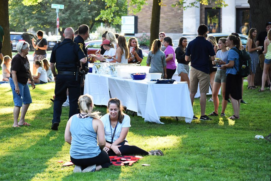 """It's a good mix. It's good seeing not just students but also older community members,"" Kelly Opie, a fourth-year biology student, said while playing checkers with a friend at Thursday's block party. Opie is also a Randall Park neighborhood resident."