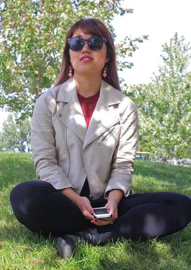 """""""I am very passionate about fashion,"""" Tomoe Hashiguchi, a first-year international business student, said. A leather jacket is a fall essential she recommends as it captures her edgy style. """"I love dressing up because the outfits show my mood and personality,"""" she said."""