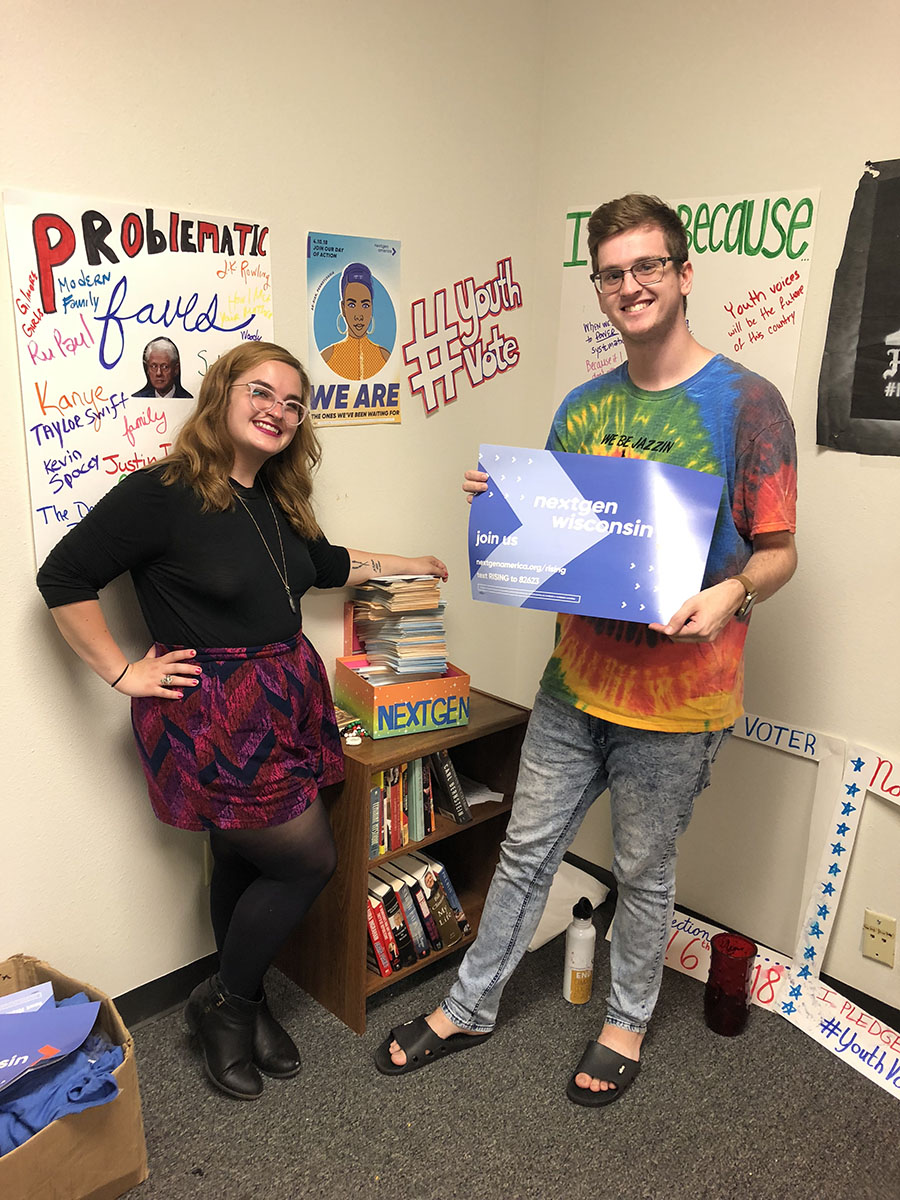 NextGen Wisconsin Fellows Kessa Albright and David Edwardson stand by their stack of recently attained