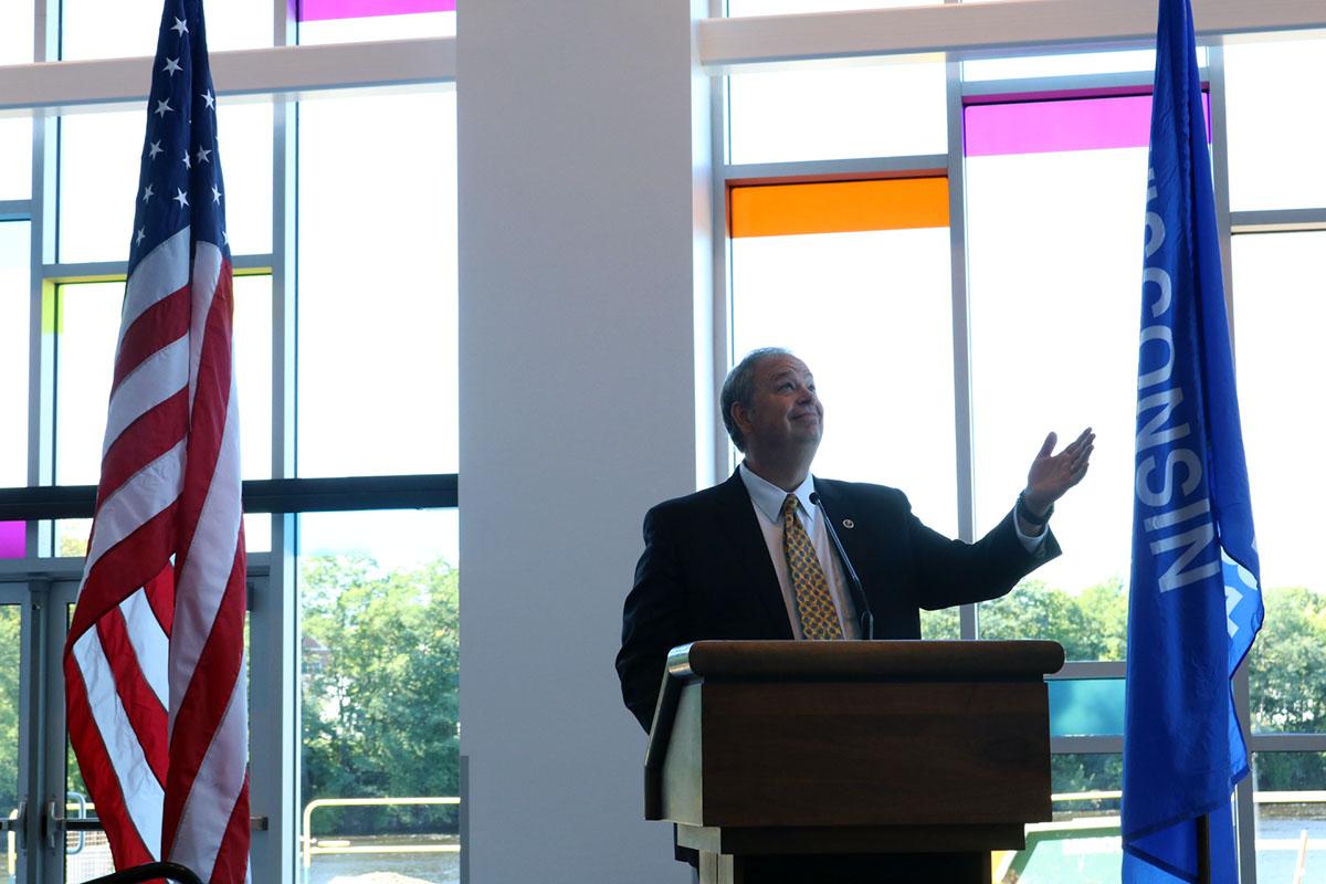 Chancellor James C. Schmidt gestures upward in acknowledgement of the new art facility.