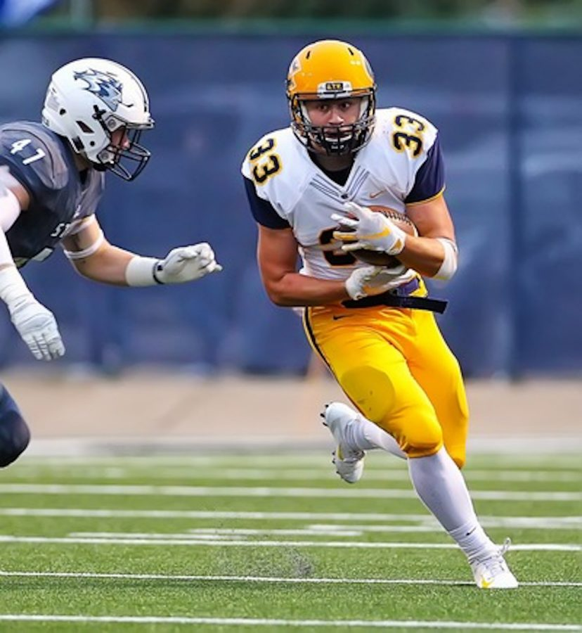 Brian Kulaga fights off the UW-Stout defense. Eau Claire will be hosting UW-Stevens Point on Oct. 6.