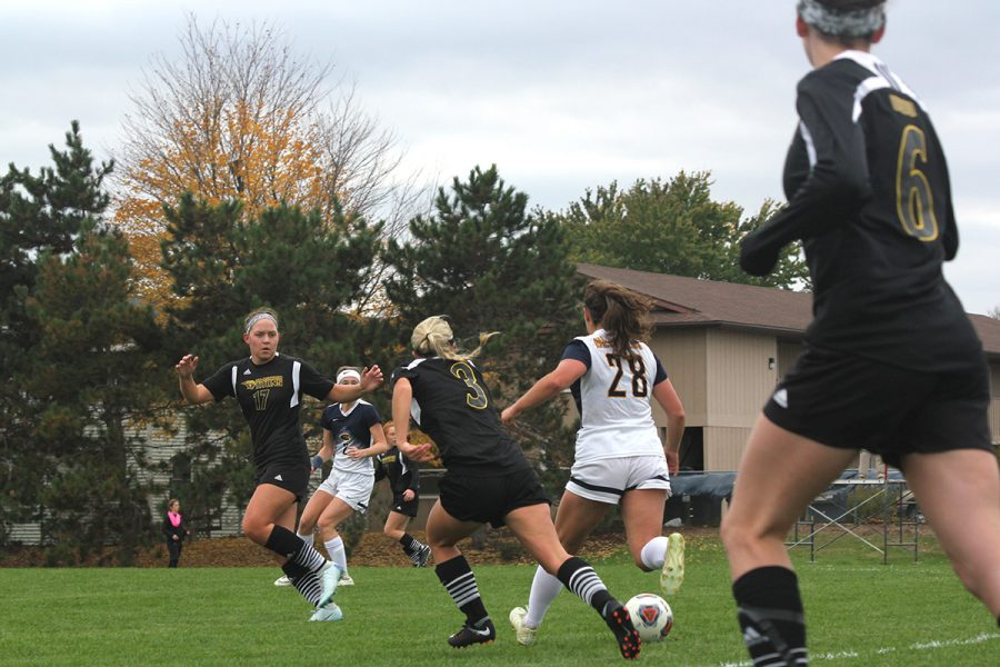 Emma Stange, a first-year midfielder, avoids her oppontents while handling the ball.