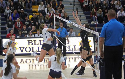Abby Volk delivers a spike against UW-Stevens Point.