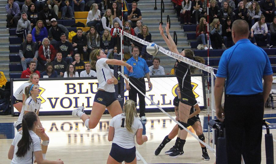 Abby+Volk+delivers+a+spike+against+UW-Stevens+Point.
