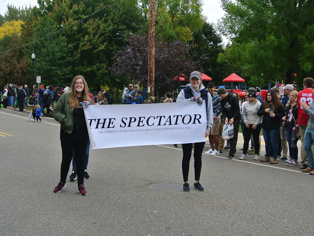 Some+of+The+Spectator+staff+were+featured+in+the+parade%2C+boasting+a+banner+and+handing+out+candy+and+newspapers.