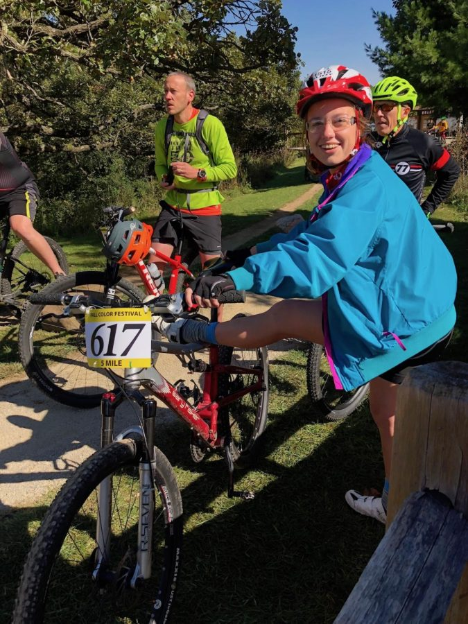 Clara Neupert stretches her hamstrings on her bike before the start of her race. Though the Fall Color Festival was in Southern Wisconsin, the Eau Claire area is home to several mountain bike trails. Mountain bikes can be rented through the Environmental Adventure Center on campus.