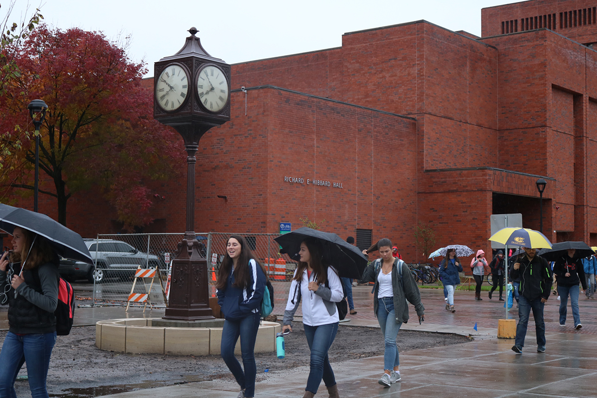 Students pass by the latest, historic addition to campus.