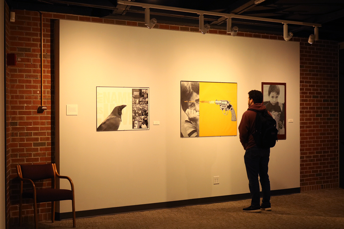 A student examines the graphic portion of the gallery.