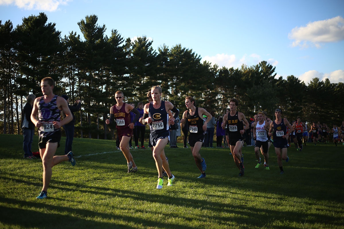 In a pack by Christian LeSac, a first-year, part of the men's cross country team works together to finish the race on Friday. Up next for the team is the UW-Oshkosh invite on Oct. 13.