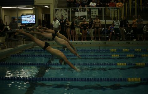 UW-Eau Claire dove and raced into various swim events as they faced the UW-Oshkosh Titans at home.
