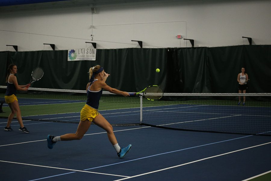 In this picture from staff files, Alexa Brooks, right, and Emma Barnd, left, face their opponents at the John & Fay Menard YMCA Tennis Center during a meet-up with UW-Stevens Point and UW-Oshkosh on Oct. 12 and 13.
