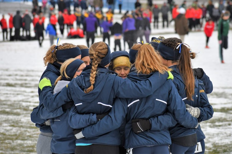 The+UW-Eau+Claire+women%27s+cross+country+team+huddles+before+their+regional+meet.+