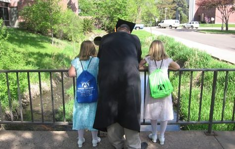 My younger sister, my older brother, and myself outside the old Davies Student Center in 2008, admiring the ducks.