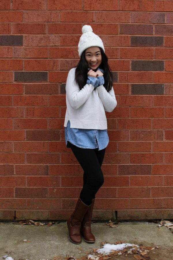 A+denim+shirt+underneath+a+sweater+can+create+an+effortless+and+cute+outfit%2C+accessorized+with+a+knit+beanie+and+some+brown+boots+to+complete+the+look.