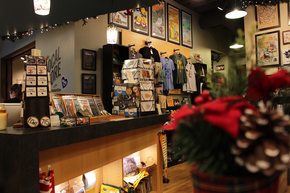 The+Local+Store+celebrated+the+season+with+festive+decorations+like+Christmas+lights%2C+poinsettia+and+pine+cones.