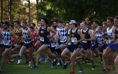 In this picture from staff files, Patrick Treacy leads the UW-Eau Claire pack at the Blugold Invite on Sept. 28. Treacy finished fourth for the Blugold men on Saturday.