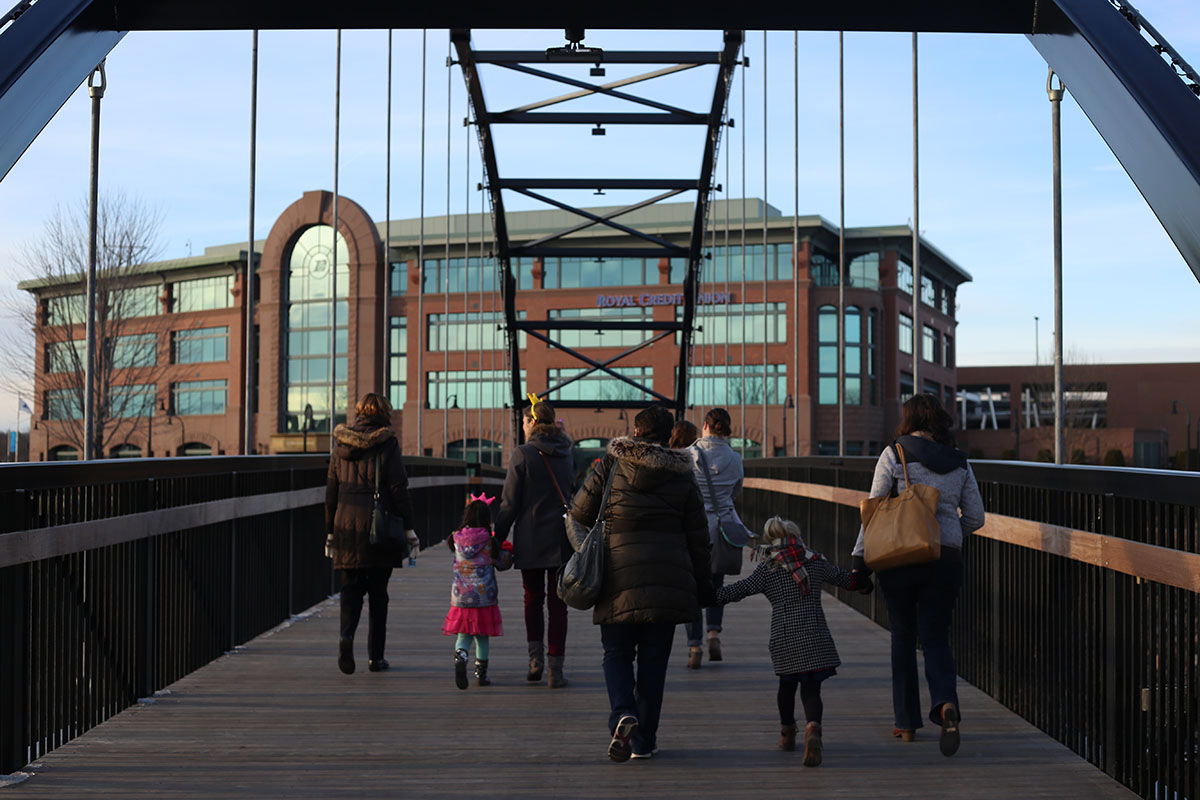 Families strolled across the most recent Eau Claire bridge to be installed this past summer.