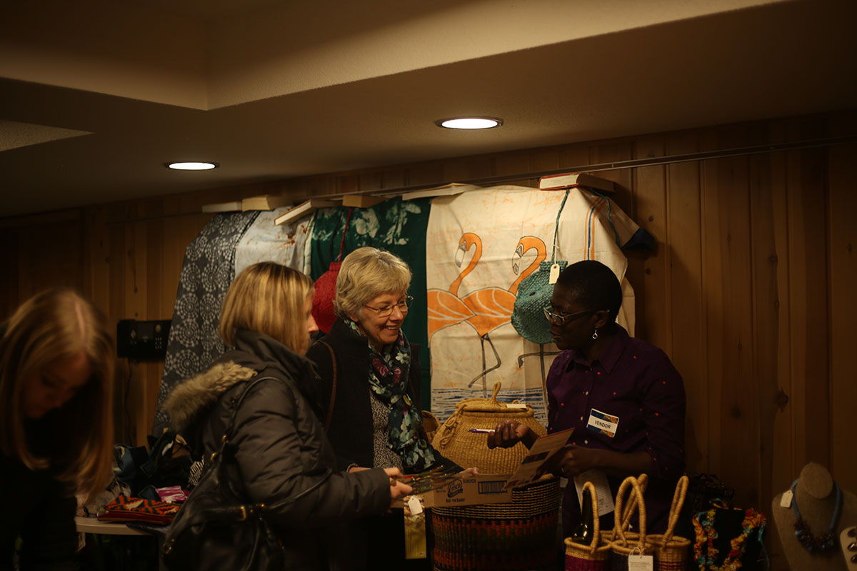 Taylor Hall, pictured here, presented Global Mama's with a variety of baskets, napkins, blankets and many more handmade objects.