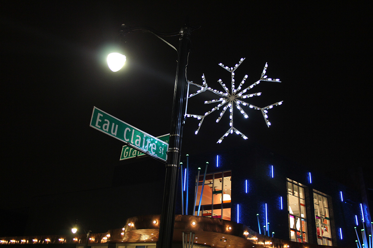 A twinkling snowflake says hello at the corner of Eau Claire Street and Grand Avenue.