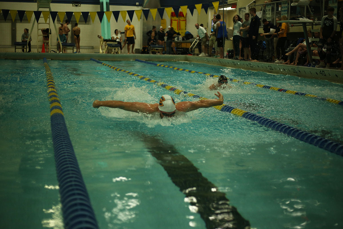 The swimming and diving teams were tapered and rested over a week before their meet in Rochester this past weekend, which allowed them to improve their speed and times in the water. This photo, from our files, captures a home meet earlier this year.