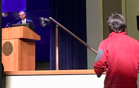 An audience member asks Barry Burden a question after his presentation on gerrymandering. Burden helped co-found the Elections Research Center at UW-Madison.