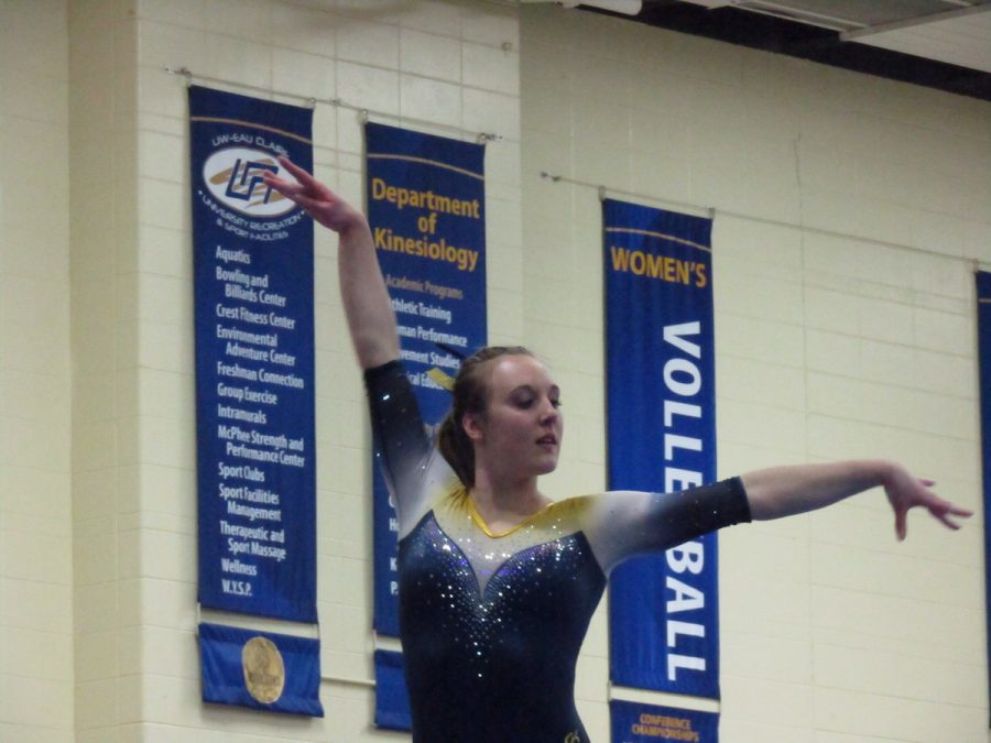 +Claire+Lorbiecki%2C+a+fourth-year+gymnast%2C+performs+her+beam+routine.+