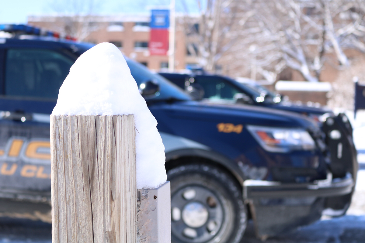 A small post stands heavy with snow, a reminder of the blizzard that has hit Eau Claire recently.