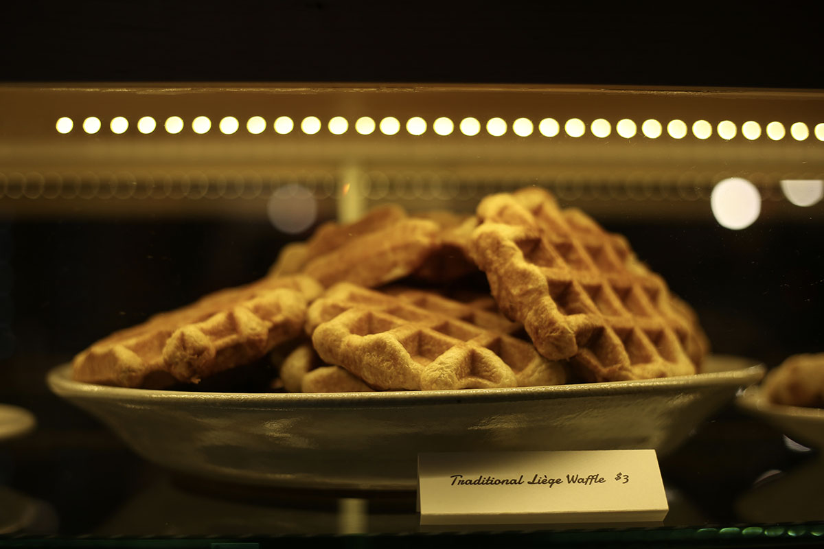 The+liege+waffle+glows+in+the+bakery+case+waiting+to+be+paired+with+its+latte.