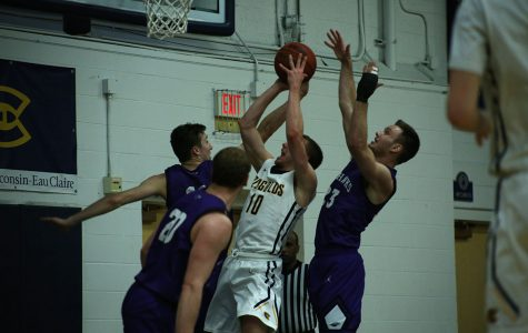 Fourth-year guard Ben Widdes fights to make a layup Saturday at Zorn Arena.
