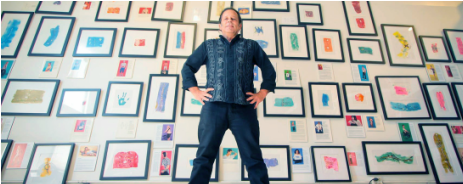 Ted Meyer stands in front of his 'Scarred for Life' collection of pieces that portray people's scars.