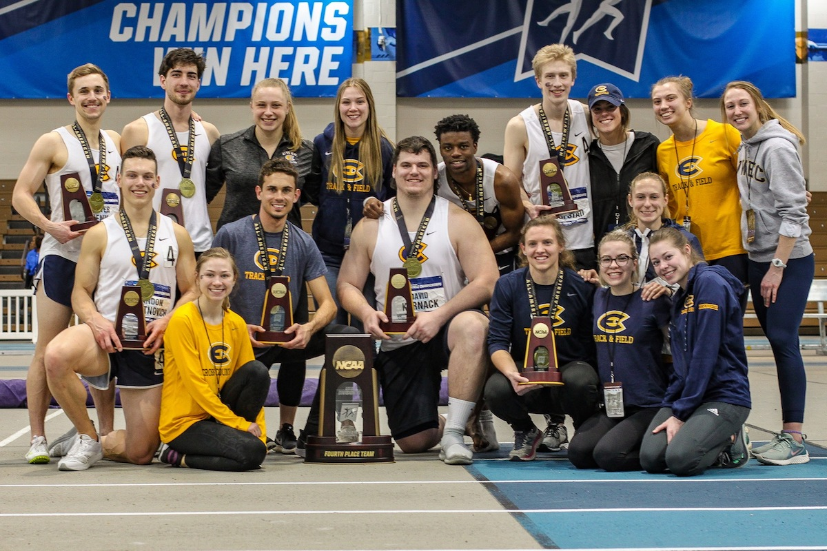 Blugold athletes gather together for a photo with their awards.