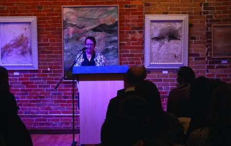 Jessi Peterson reads some of her work at the 6x6 Reading Series event on Tuesday. Readers at the event are only allowed six minutes to read their pieces before the next reader steps up.