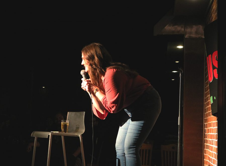 +Brittany+Tilander+interacts+with+the+audience+while+she+tells+jokes+and+stories+last+Thursday+at+The+Plus.+