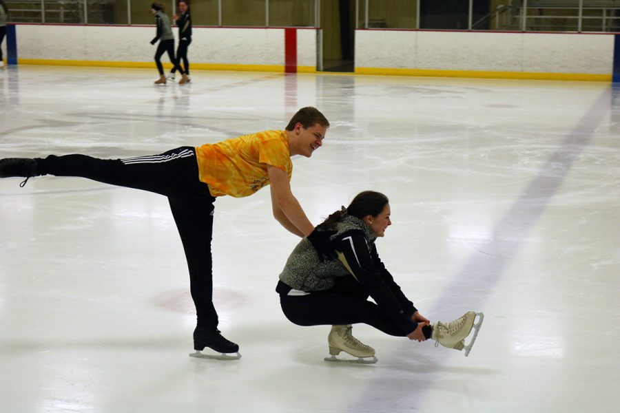 Two teammates, Timmy Zupanc and Alexandra O'Hara choose an elegant way to warm up.