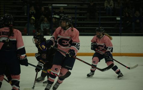 In this photo from our staff archives, Erin Goodell, a fourth-year forward, takes the puck down the ice.