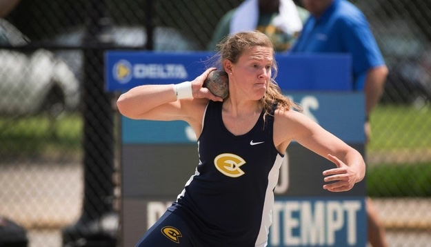 Erica Oawster, a fourth-year athlete, throws shot put.