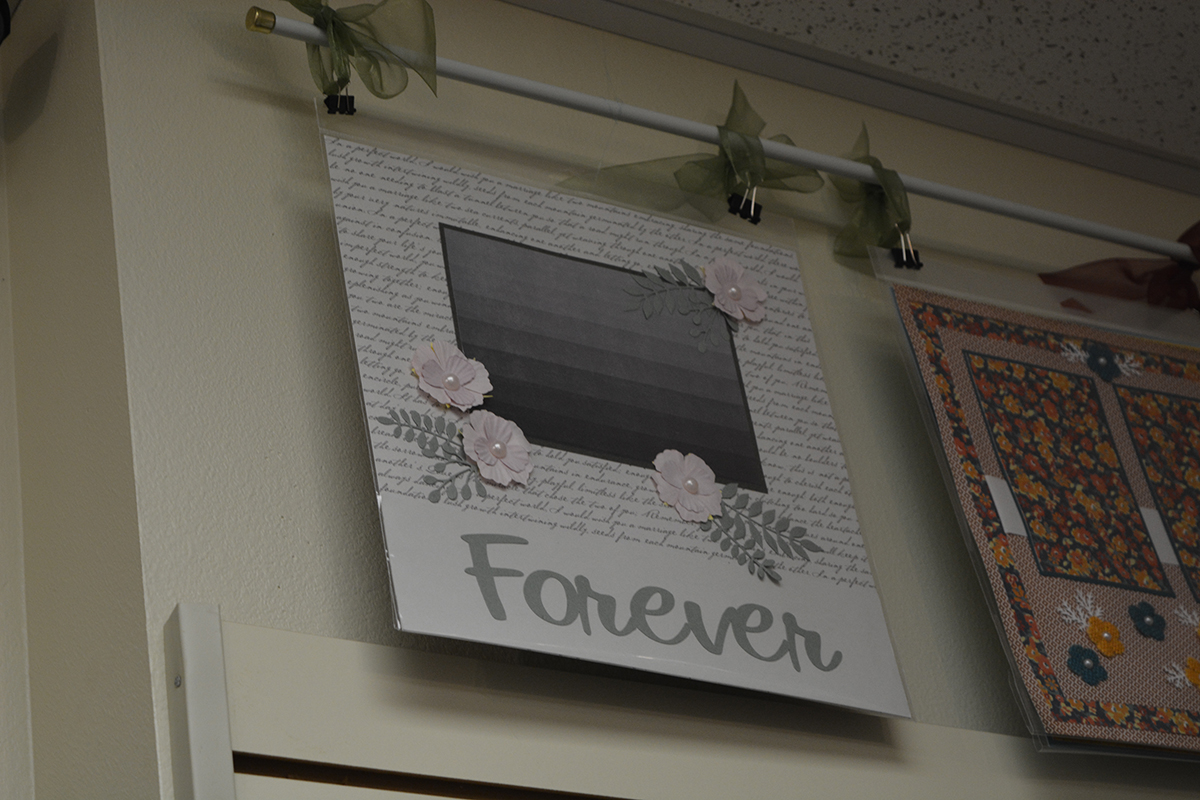 A+scrapbooking+sample+that+Olivia+Solberg%2C+a+store+employee+at+Picture+This%2C+created.+She+was+inspired+by+the+flowers+and+created+the+design+by+herself%2C+she+said.+