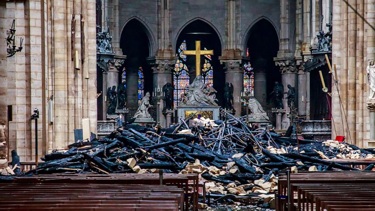 The main altar of Notre-Dame is surrounded by debris after the fire was doused.