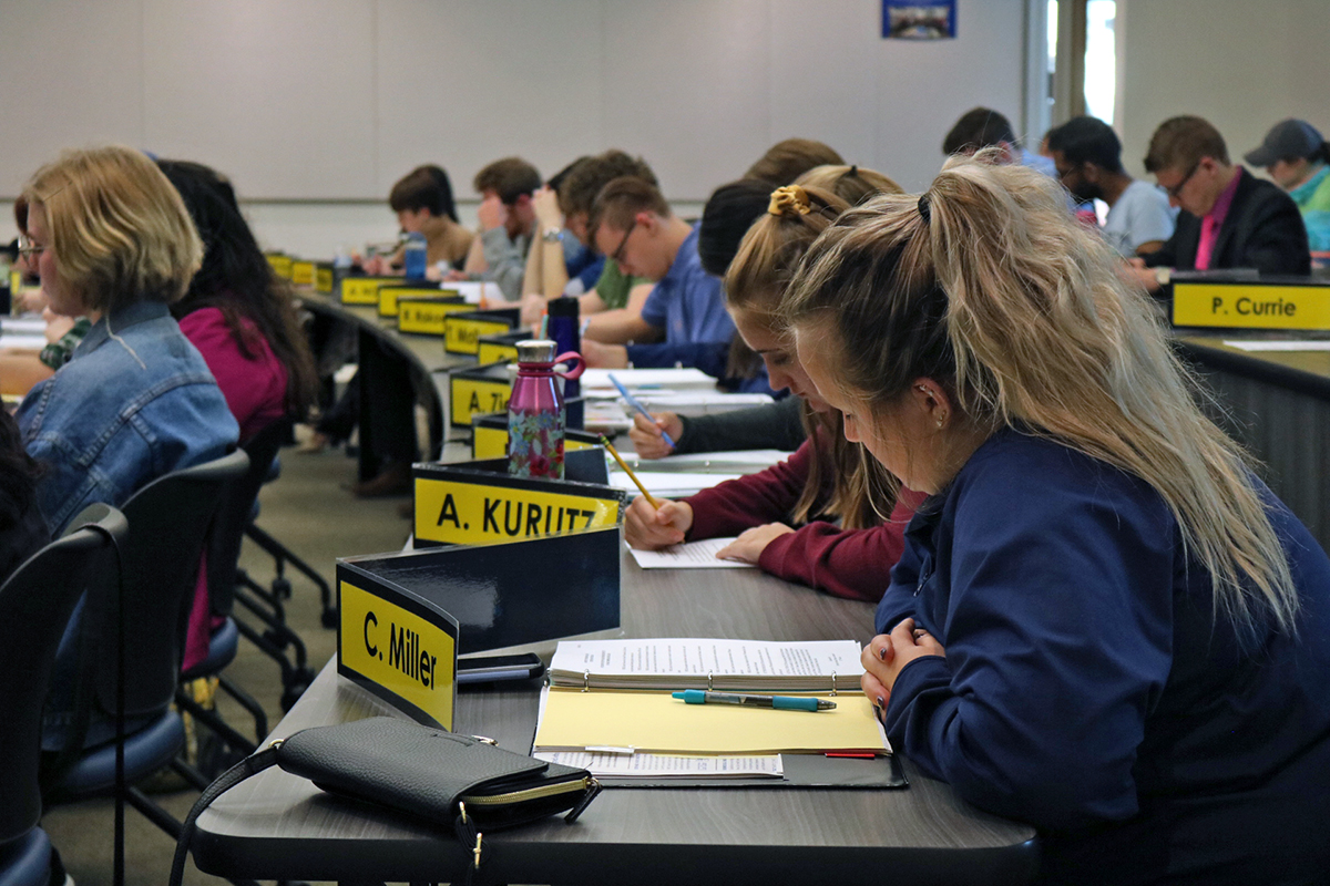 """Alexandra Kurutz, the campus affairs director, introduces a proposal for a name change from """"Campus Affairs"""" to """"Student Organization Commission."""""""