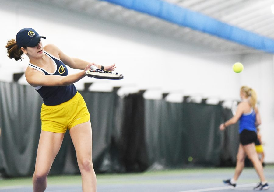 Lindsey+Henderson%2C+a+first-year+athlete%2C+returns+a+ball+during+the+doubles+match+against+St.+Scholastica+on+Sunday+afternoon.