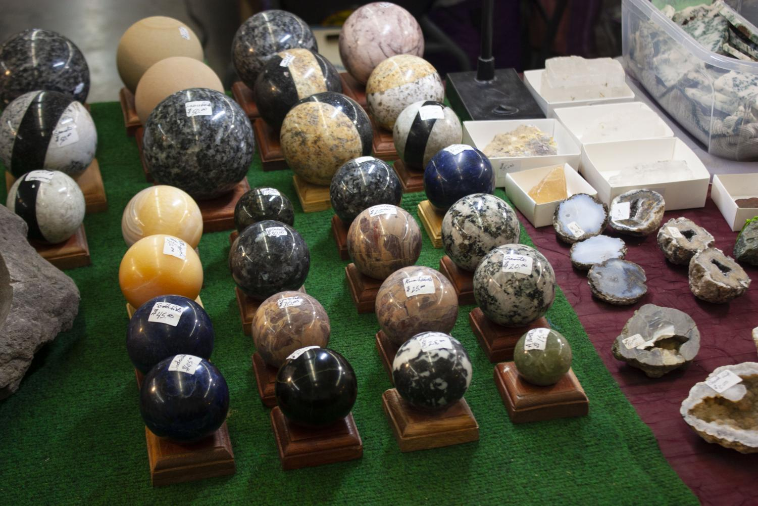A+number+of+colorful+stones+and+agates+have+been+molded+and+polished+into+decorative+spheres.++