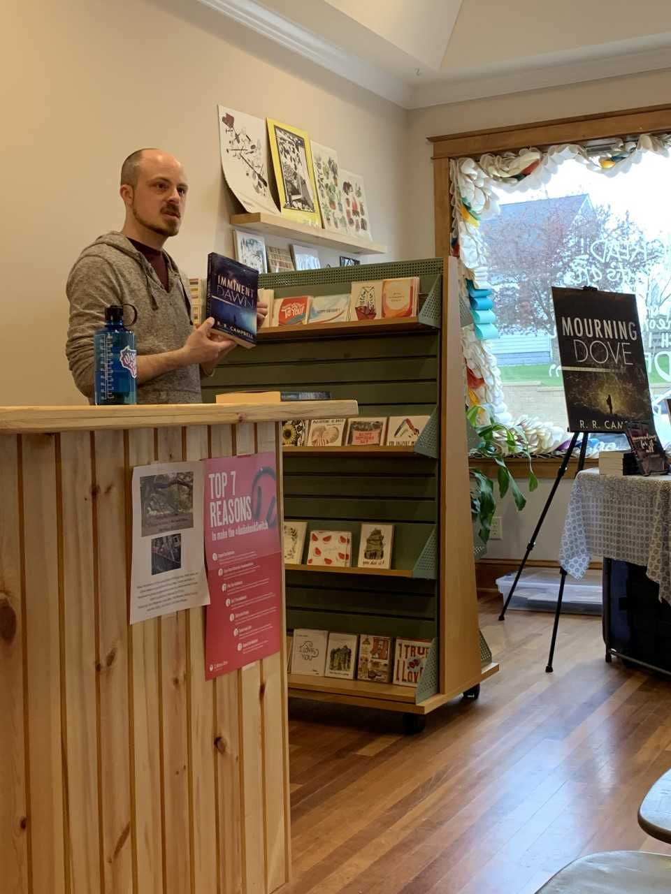 Ryan Campbell, a local author, presents his novel at his book launch event at Dotter's Bookstore