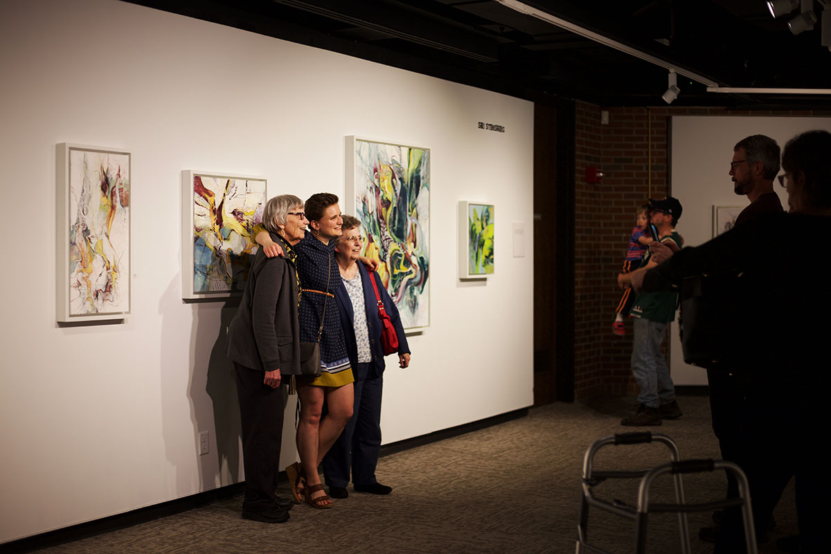 Stensberg+smiles+with+some+viewers+and+stands+for+a+photo+on+opening+night.+