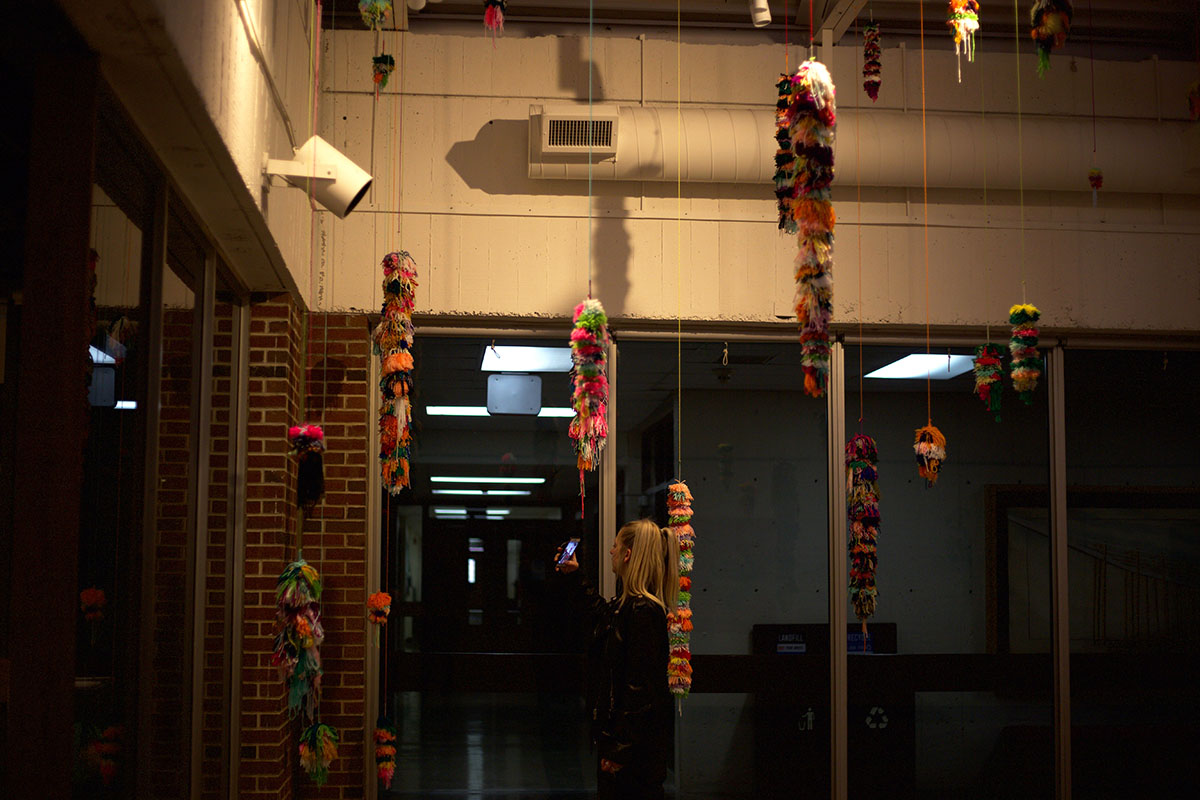 Fischer+takes+videos+of+her+hanging+yarn+fixtures+for+her+viewers+on+the+other+side+of+the+screen.