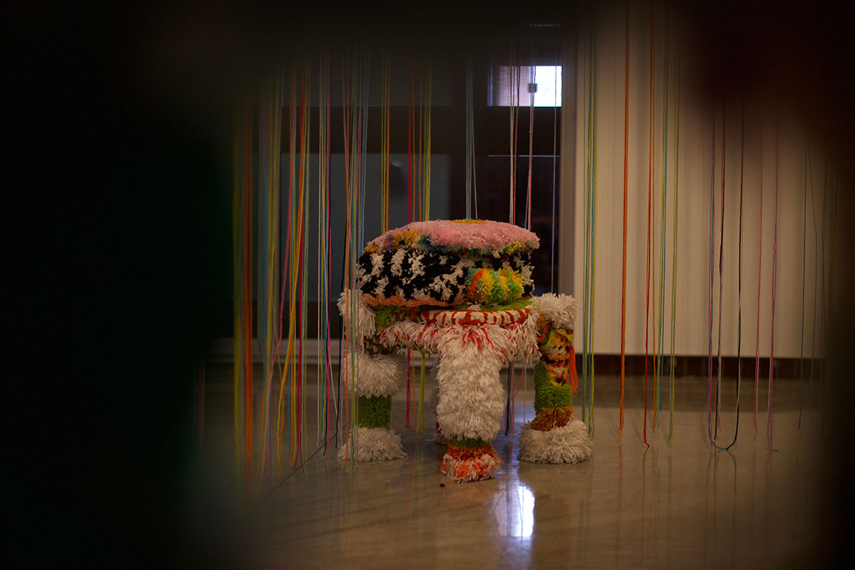 I+saw+it+through+the+grape+yarn%3F+A+jewelry+box+covered+in+yarn+sits+upon+a+bedside+yarn+table.