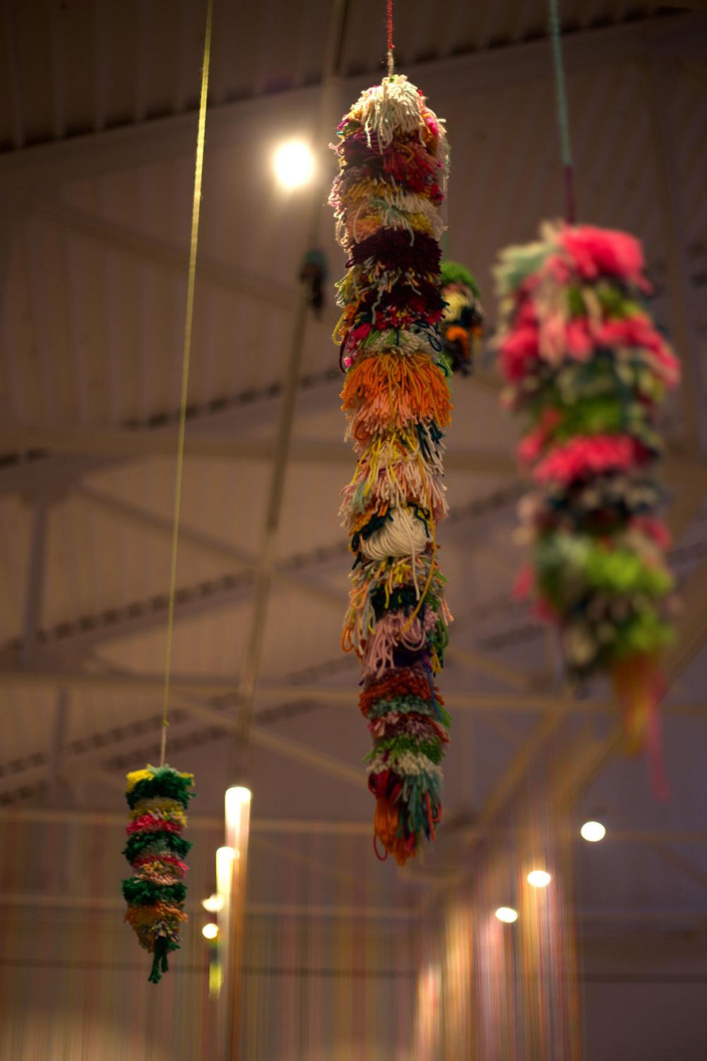 Fischer+created+hanging+plants+in+the+design+of+yarn+for+viewers+to+gaze+at.+